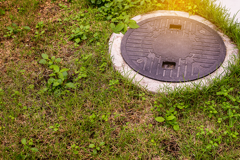 Opening to a residential septic system seen while preforming home inspection