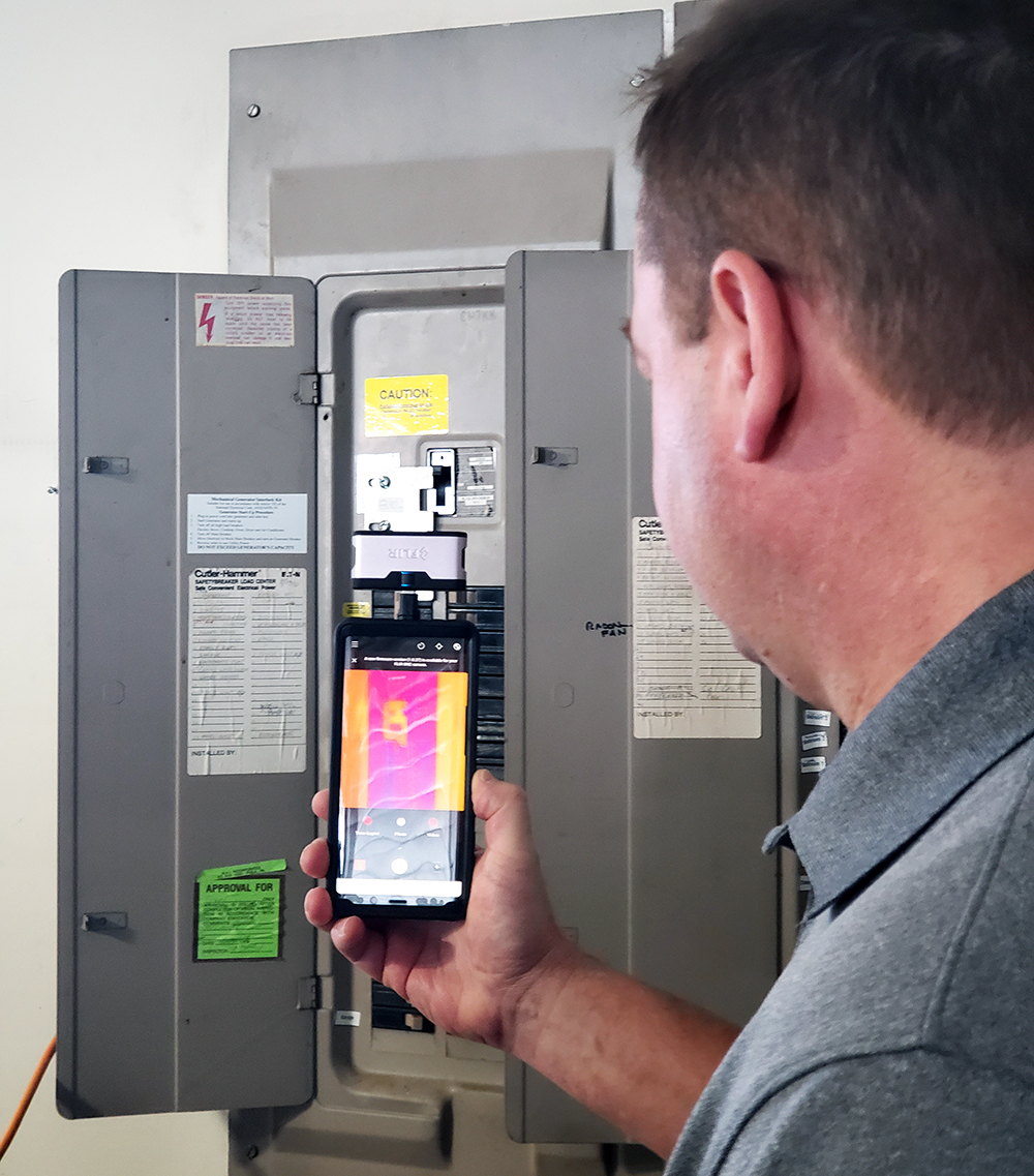John Harper, one of our home inspectors, using a thermal imaging camera during an inspection