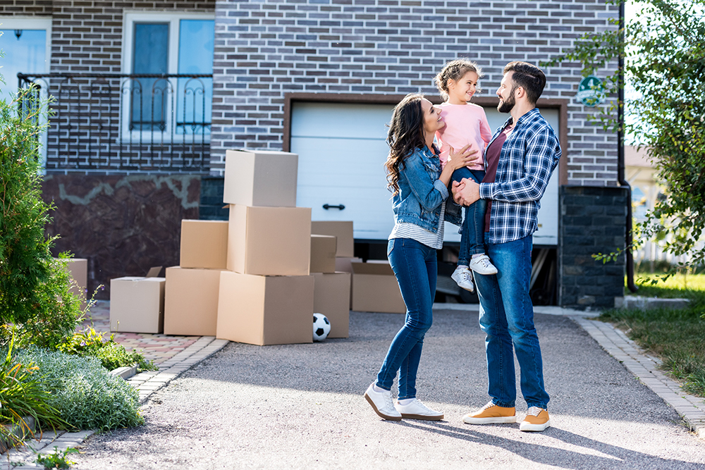 Happy family of three moving into their new house after a home inspection
