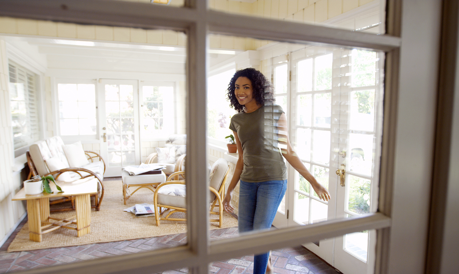 Happy woman inside of her new house after a home inspection